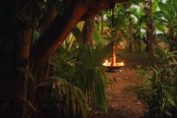 Yoga garden at night with oil lamp for relaxing atmosphere