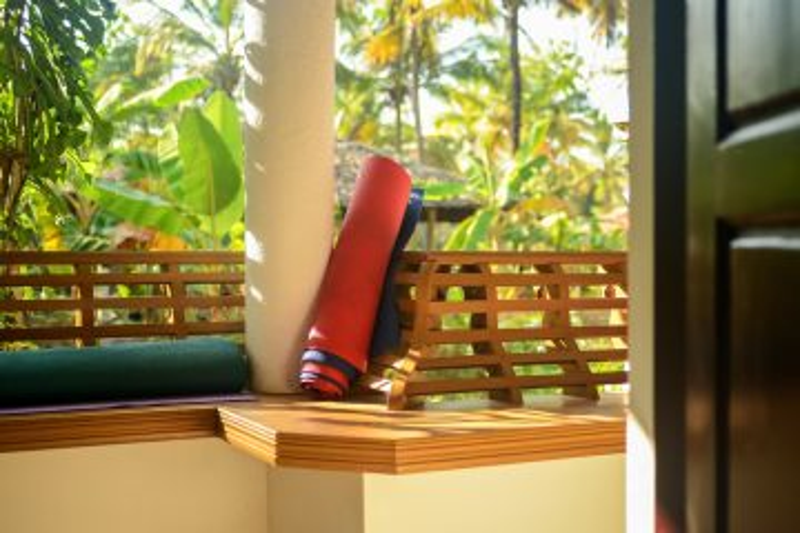 Yoga mats on balcony at yoga retreat house